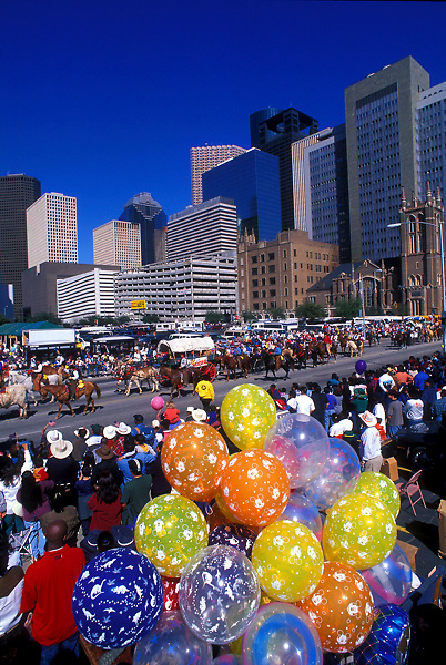 Trail ride headed to the Houston rodeo through downtown