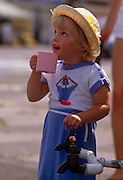 A young girl drinks fresh water from a water tanker, provided by Thames Water during the southern England drought of 1989. During the heatwave that saw reservoirs depleted and in the south west, dry up altogether..A hosepipe ban and in some areas, tap water failed too so tankers stationed in affected areas so locals could fill up for essential use. Tourism increased as people visited tourist areas e.g. beaches at the weekends and took holidays in the UK rather than travelling abroad for the sun