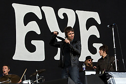 © licensed to London News Pictures . 30/06/2012 . Manchester , UK . Beady Eye , fronted by Liam Gallagher , perform on stage at Heaton Park . Liam Gallagher pulls a piece of black cloth between his hands as he crosses the stage during his performance . The band are playing as warm up for the Stone Roses , who are on their comeback tour . Photo credit : Joel Goodman/LNP