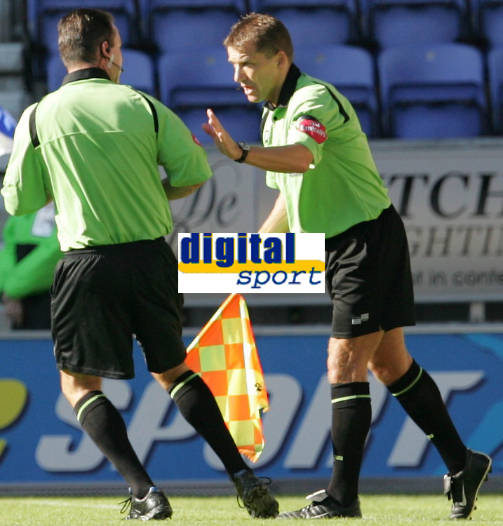 Photo: Andi Thompson.<br />Wigan Athletic v Watford. The Barclays Premiership. 23/09/2006.<br />Referee Rob Styles (l) consults with his assistant before awarding the Wigan Goal.