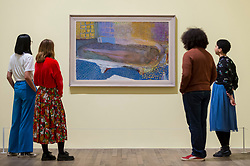 "© Licensed to London News Pictures. 21/01/2019. LONDON, UK. Staff members view ""Nude in the Bath"", 1936, by Pierre Bonnard.  Preview of an exhibition called ""Pierre Bonnard: The Colour of Memory"" at Tate Modern.  This is the UK's first major Pierre Bonnard exhibition in 20 years bringing together around 100 of his works from around the world covering a period from 1912 to his death in 1947.  The works are on show 23 January to 6 May 2019.  Photo credit: Stephen Chung/LNP"