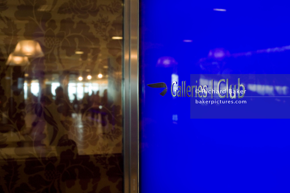 "We see a welcome screen at the British Airways Galleries Club lounge at Heathrow Airport's Terminal 5. This exclusive facility is only available to passengers travelling open to passengers travelling in First, Club World and Club Europe as well as Gold and Silver Executive Club members and was designed by Artwise. The lounge's 15,000 sq ft complex was built at the cost of £60 million. From writer Alain de Botton's book project ""A Week at the Airport: A Heathrow Diary"" (2009). ."