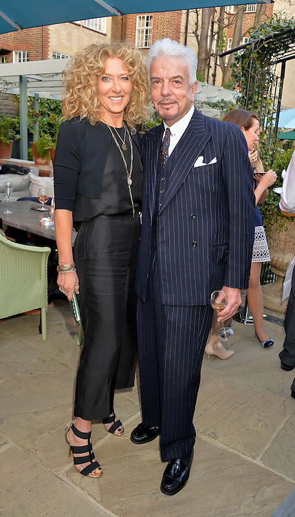 PICTURE SHOWS:-KELLY HOPPEN and NICKY HASLAM.<br /> Tuesday 14th April 2015 saw a host of London influencers and VIP faces gather together to celebrate the launch of The Ivy Chelsea Garden. Live entertainment was provided by jazz-trio The Blind Tigers, whilst guests enjoyed Moët & Chandon Champagne, alongside a series of delicious canapés created by the restaurant's Executive Chef, Sean Burbidge.<br /> The evening showcased The Ivy Chelsea Garden to two hundred VIPs and Chelsea<br /> residents, inviting guests to preview the restaurant and gardens which marry<br /> approachable sophistication and familiar luxury with an underlying feeling of glamour and theatre. The Ivy Chelsea Garden's interiors have been designed by Martin Brudnizki Design Studio, and cleverly combine vintage with luxury, resulting in a space that is both alluring and down-to-earth.
