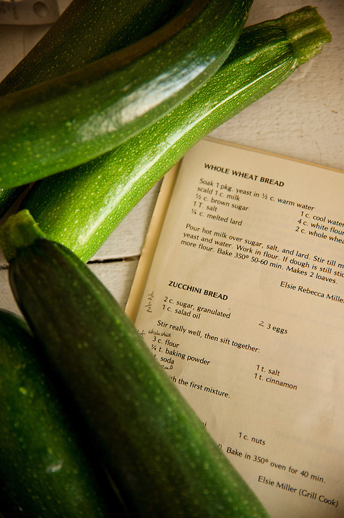 Fresh zucchini frame a cookbook with a zucchini bread recipe while baking at St. Helena Island Lighthouse.