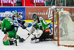 Danny Irmen (EHC Liwest Linz, #9) vs Matija Pintaric (HDD Tilia Olimpija, #69) during ice-hockey match between HDD Tilia Olimpija and EHC Liwest Black Wings Linz at second match in Semifinal  of EBEL league, on March 8, 2012 at Hala Tivoli, Ljubljana, Slovenia. (Photo By Matic Klansek Velej / Sportida)