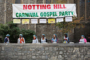 Members from Kensington Temple congregation, a Pentecostal church, serve hot food during the Notting Hill Carnival on the 27th August 2018 in London in the United Kingdom. The Notting Hill Carnival is an annual event held over two days of the August Bank Holiday weekend. It has taken place in London since 1966 on the streets of Notting Hill, in the Royal Borough of Kensington and Chelsea and the City of Westminster.