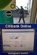 Moscow, Russia, 20/03/2005..Citibank kiosk and ATM with internet connection in a BP service station where bank repesentatives canvas customers.