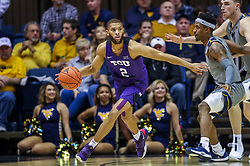 Jan 14, 2020; Morgantown, West Virginia, USA; TCU Horned Frogs guard Edric Dennis (2) dribbles while defended by West Virginia Mountaineers guard Brandon Knapper (2) during the second half at WVU Coliseum. Mandatory Credit: Ben Queen-USA TODAY Sports