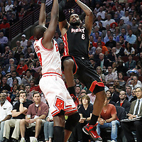 14 March 2012: Miami Heat small forward LeBron James (6) takes a jumpshot over Chicago Bulls small forward Luol Deng (9) during the Chicago Bulls 106-102 victory over the Miami Heat at the United Center, Chicago, Illinois, USA.