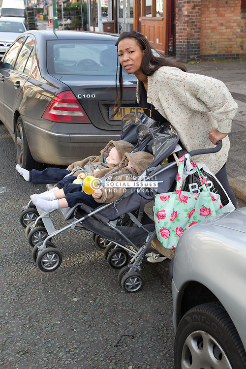 Mother with twins in buggy trying to cross road. (This photo has extra clearance covering Homelessness, Mental Health Issues, Bullying, Education and Exclusion, as well as the usual clearance for Fostering & Adoption and general Social Services contexts,)