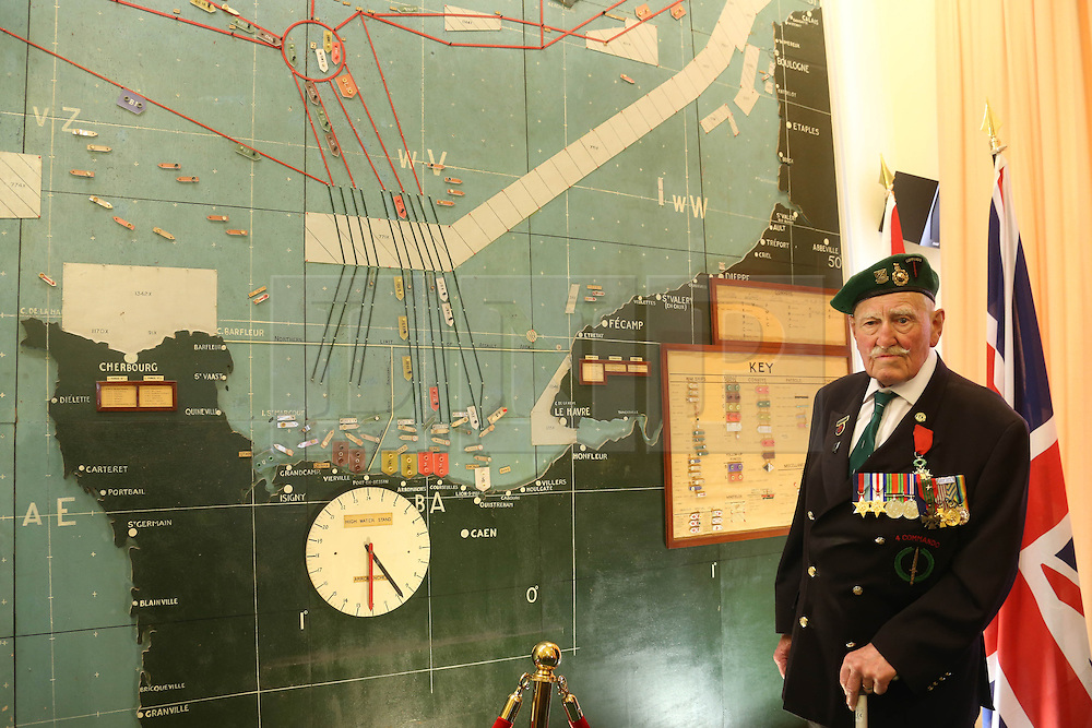 © Licensed to London News Pictures. 02/06/2014. Portsmouth, UK. 90 year old D Day veteran Pat Churchill of Witney of 4 Commando who landed on Juno beach pictured with the D DAY map at Southwick house near Portsmouth.  D-Day Veterans visit Portsmouth Historic Dockyard and the D-Day boats moored there including the MTB which carried Churchill and General Eisenhower on a review of the armada assembled for D-Day invasion.. Photo credit : Jason Bryant/LNP