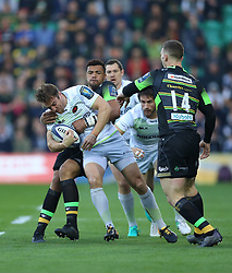 Northampton Saints Chris Wyles is tackled by Saracens Luther Burrell during the Champions Cup match at Franklin's Gardens, Northampton.