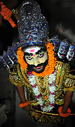 September 26, 2016 - Allahabad, Uttar Pradesh, India - An Artist dressed as Demon king Rawan ahead of a religious procession Ravan ki Barat in Allahabad, held to mark the Dussehra festival. The name Dussehra is derived from Sanskrit Dasha-hara literally means removal of ten referring to Lord Rama's victory over the ten-headed demon king Ravana. Dussehra is celebrated on the tenth day of the month of Ashwin according to the Hindu calendar which corresponds to September or October of the Gregorian calendar. (Credit Image: © Prabhat Kumar Verma via ZUMA Wire)