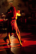 Couples dancing in El Catedral milonga, silhouette, Buenos Aires, Federal District, Argentina.