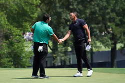 August 10, 2018 - St. Louis, Missouri, United States - Brooks Koepka (R) shakes hands with Patrick Reed on the 9th green after the second round of the 100th PGA Championship at Bellerive Country Club. (Credit Image: © Debby Wong via ZUMA Wire)