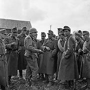Hungarian army surrendering in Austria, May 1945. American photographer Ray Fisher speaks with them.