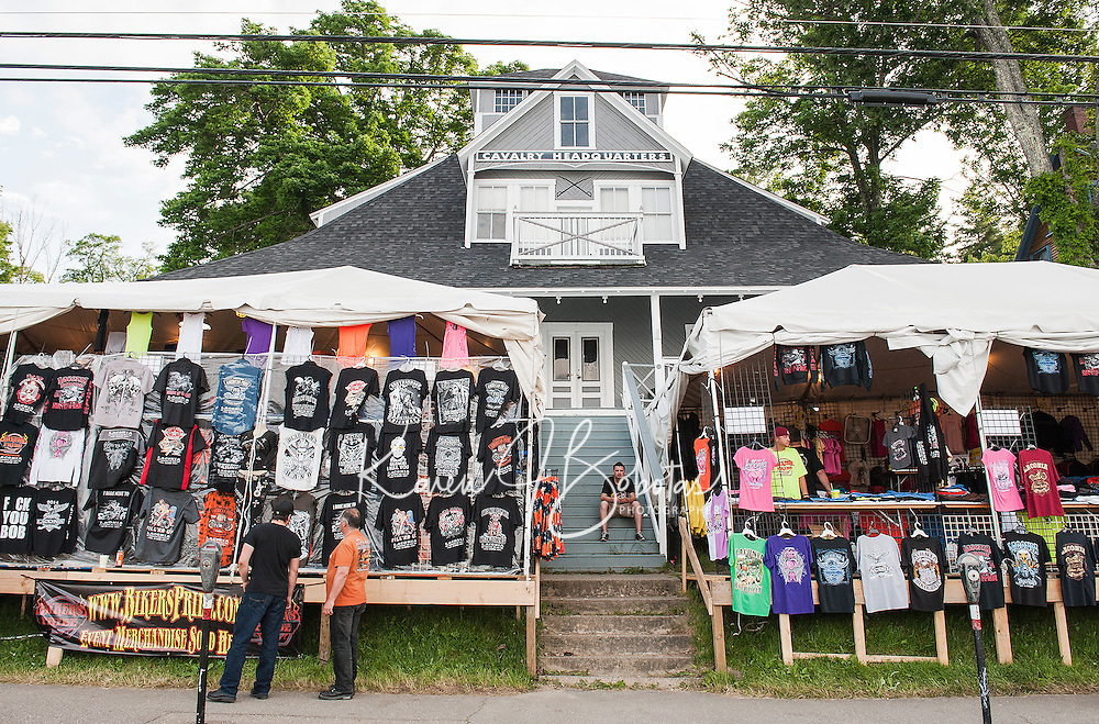 A multiplude of T Shirts for sale line Lakeside Avenue during Laconia's Motorcycle Week.  (Karen Bobotas/for the Laconia Daily Sun)