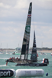 © Licensed to London News Pictures. 25/07/2015. Portsmouth, UK. Team Land Rover BAR (Ben Ainslie Racing) crossing the line in first place in race one of the first leg of the America's Cup World Series in Portsmouth this weekend. Today, 25th July 2015, is the first race day in which British Olympic sailing legend, Sir Ben Ainslie, will be leading his all-British team, Land Rover BAR, against other teams in a battle to qualify for a place in the two team America's Cup final, to be held in Bermuda in 2017.  Photo credit : Rob Arnold/LNP