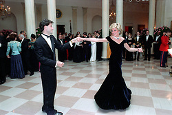 November 9, 1985 - Washington, District of Columbia, United States of America - In this photo provided by the Ronald Reagan Presidential Library, Princess Diana dances with John Travolta in the Cross Hall of the White House in Washington, D.C. at a Dinner for Prince Charles and Princess Diana of the United Kingdom on November 9, 1985...Mandatory Credit: Pete Souza - Courtesy Ronald Reagan Library via CNP (Credit Image: © Pete Souza/CNP via ZUMA Wire)