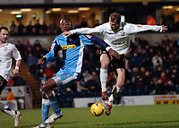 Photo: Kevin Poolman.<br />Wycombe Wanderers v Hereford United. Coca Cola League 2. 01/01/2007. Trent McClenahan of Hereford gets ahead of Wycombe's Fola Onibuje.