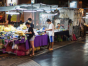 26 MAY 2016 - BANGKOK, THAILAND:  Vendors set up their booths at the Silom Road night market. The night market on Silom Road, close to Bangkok's famous Patpong tourist area, is being closed by the Bangkok municipal government. Vendors have been told they have to leave the sidewalk on Silom Road by the end of May, 2016. The market is the latest street market being shut down by city officials as a part of the government's plan to clean up Bangkok. The Silom Road night market sells mostly tourist oriented clothes, inexpensive Thai art, and bootleg movies on DVD.      PHOTO BY JACK KURTZ