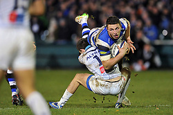 Sam Burgess of Bath Rugby is tackled to ground - Photo mandatory by-line: Patrick Khachfe/JMP - Mobile: 07966 386802 12/12/2014 - SPORT - RUGBY UNION - Bath - The Recreation Ground - Bath Rugby v Montpellier - European Rugby Champions Cup