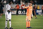 Real Salt Lake goalkeeper Nick Rimando, right, and Los Angeles Galaxy forward Edson Buddle share a laugh after their MLS soccer match, Saturday, March 10, 2012, in Carson, Calif. Real Salt Lake won 3-1.(AP Photo/Bret Hartman)