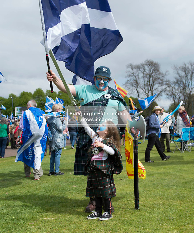 Four year old Kayla from Glasgow shows her support for Independence during the Rally on Glasgow Green organised by All under One Banner, Scottish Independence Supporters walk through the Streets of Glasgow in a Pro Independence March, Angie Isac | EEm Thursday 11 May 2017
