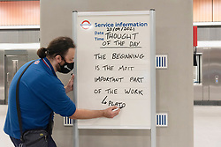 © Licensed to London News Pictures. 20/09/2021. London, UK. A TLF member of staff writes the first Thought Of The Day on a notice board on the first day Battersea Power tube station opens.  Along with Nine Elms station, the new Norther Line London underground stations is the first major expansion of the Tube since the Jubilee line in the 1990s. Photo credit: Ray Tang/LNP