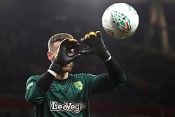 24 October 2017 - Football League Cup Round of 16 - Arsenal v Norwich City - The eye of Norwich goalkeeper Angus Gunn can be seen through his gloved fingers as he catches the ball - Photo: Charlotte Wilson / Offside