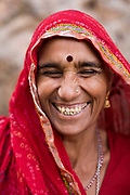 A woman laughing at the Surya Mandir (known as the Monkey Temple), Jaipur, India