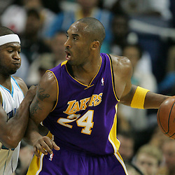 23 December 2008: Los Angeles Lakers guard Kobe Bryant (24) works against New Orleans Hornets guard Devin Brown (23) during a 100-87 loss by the New Orleans Hornets to the Los Angeles Lakers at the New Orleans Arena in New Orleans, LA. .
