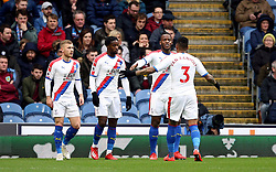 Crystal Palace's Michy Batshuayi and Patrick van Aanholt celebrate their side's first goal, an own goal by Burnley's Phillip Bardsley (not in picture) during the Premier League match at Turf Moor, Burnley.