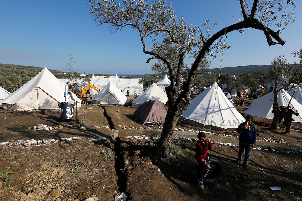 Migrant children play at a makeshift camp near the village of Moria on the Greek island of Lesbos, January 29, 2016. RPhoto: Darrin Zammit Lupi