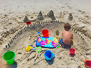 9-year-old boy, sand castle, NJ shore, Cape May