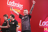 Nathan Aspinall celebrates winning his first leg during the PDC Ladrokes Masters 2021 at Marshall Arena, Milton Keynes, United Kingdom on 31 January 2021.