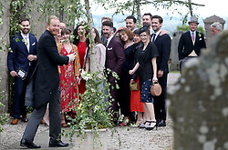 Guests pose for a group photograph, including Ben Aldridge (right) at Rayne Church, Kirkton of Rayne in Aberdeenshire, for the wedding ceremony of Game Of Thrones stars Kit Harington and Rose Leslie.