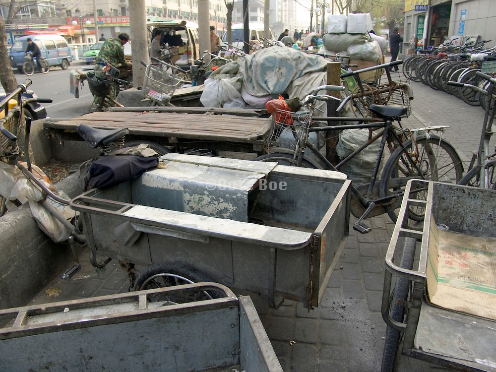 parked bicycle carts waiting Beijing China