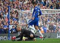 Football - 2016/2017 Premier League - Chelsea V Leicester.<br /> <br /> Kasper Schmeichel of Leicester City dives at the feet of Diego Costa of Chelsea at Stamford Bridge.<br /> <br /> COLORSPORT/DANIEL BEARHAM