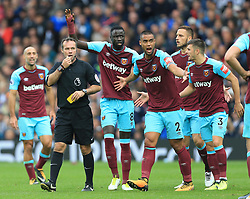 16th September 2017 - Premier League - West Bromwich Albion v West Ham United - West Ham players Cheikhou Kouyate (L), Winston Reid (2L), Marko Arnautovic (2R) and Aaron Cresswell (R) surround referee Paul Tierney - Photo: Simon Stacpoole / Offside.
