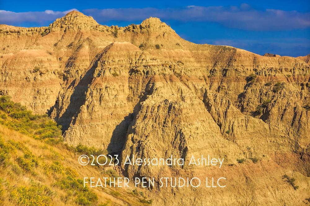 Sunlight reveals textures of desert landscape.  Badlands, South Dakota.