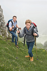 Father and son hiking in mountains Alps