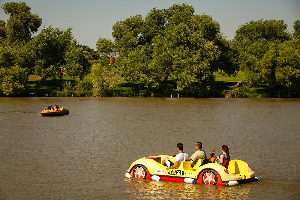 People are seen on paddle and motor boats at the lake of Park Hayarkon in Tel Aviv's Tzafon Yashan neighborhood