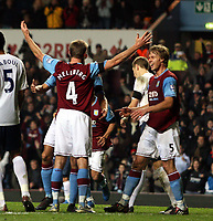 Photo: Mark Stephenson/Sportsbeat Images.<br /> Aston Villa v Tottenham Hotspur. The FA Barclays Premiership. 01/01/2008.Villa's Olof  Mellberg celebrates his goal with team mates fro 1-0 in the first half