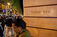 Pedestrians walk past a Tiffany & Co luxury store on the famous Champs Elysees boulevard in Paris, France (October 28, 2013)