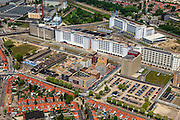 Nederland, Noord-Brabant, Eindhoven, 27-05-2013; Strijp-S, voormalige Philipsterrein, was niet toegankelijk voor het publiek, 'de verboden stad'. Het gebied, met diverse Rijksmonumenten, wordt ontwikkeld voor wonen, werken en cultuur.<br /> <br /> Boven in beeld Philitefabriek met Klokgebouw (Strijp S), in het midden het Veemgebouw met daar direct naast De Hoge (Witte) Rug. Links onder in beeld, in baksteen het voormalige NatLab. <br /> <br /> Strijp-S, former Philips area, was not accessible to the public, 'the forbidden city'. The area, with several national monuments, is designated for living, working and culture.<br /> <br /> Top image Philitefabriek / Clock Building (Strijp S), in the middle of the Veemgebouw next to the High (White) Back. Bottom left in the former NatLab (brick building). <br /> <br /> luchtfoto (toeslag op standard tarieven);<br /> aerial photo (additional fee required);<br /> copyright foto/photo Siebe Swart
