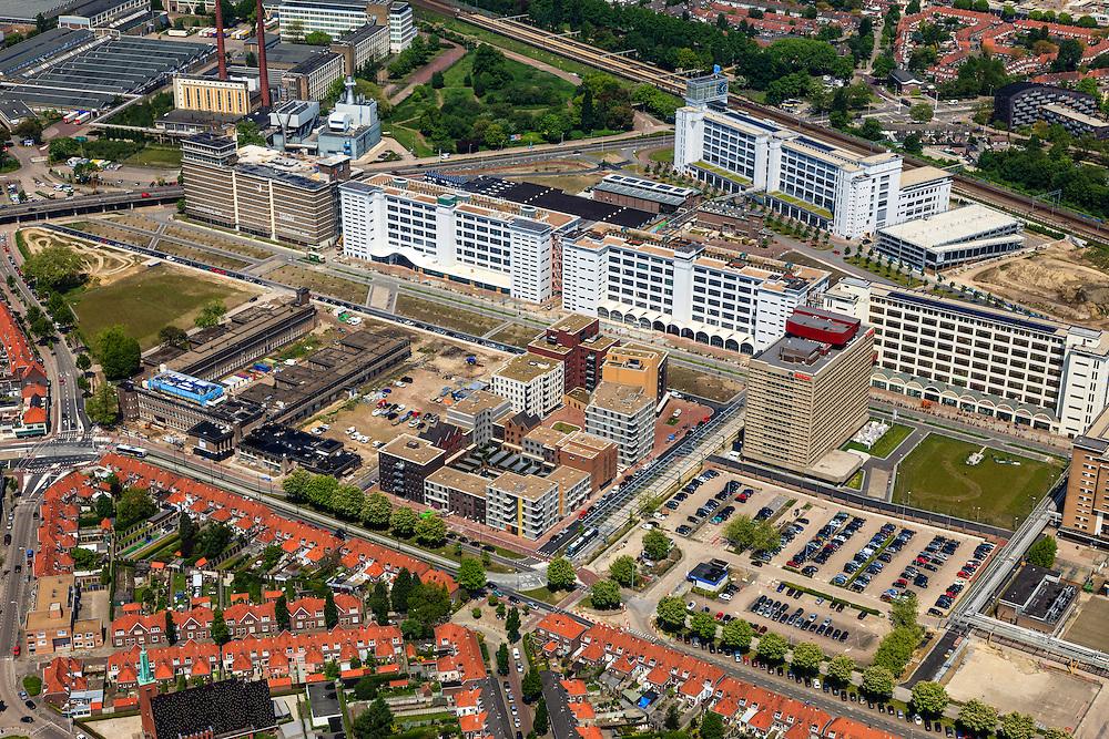 Nederland, Noord-Brabant, Eindhoven, 27-05-2013; Strijp-S, voormalige Philipsterrein, was niet toegankelijk voor het publiek, 'de verboden stad'. Het gebied, met diverse Rijksmonumenten, wordt ontwikkeld voor wonen, werken en cultuur.<br /> <br /> Boven in beeld Philitefabriek met Klokgebouw (Strijp S), in het midden het Veemgebouw met daar direct naast De Hoge (Witte) Rug. Links onder in beeld, in baksteen het voormalige NatLab. <br /> <br /> Strijp-S, former Philips area, was not accessible to the public, 'the forbidden city'. The area, with several national monuments, is designated for living, working and culture.<br /> <br /> Top image Philitefabriek / Clock Building (Strijp S), in the middle of the Veemgebouw next to the High (White) Back. Bottom left in the former NatLab (brick building). <br /> <br /> luchtfoto (toeslag op standard tarieven);<br /> aerial photo (additional fee required);<br /> copyright foto/photo Siebe Swart
