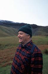 Older man on walk in countryside