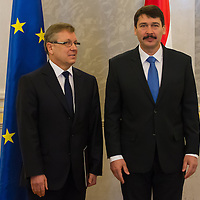 Hungary's newly minted central bank Governor Gyorgy Matolcsy (L) and Janos Ader (R) president of Hungary pose for a photograph after the swearing-in ceremony at the Presidential palace in Budapest, Hungary on March 06, 2013. ATTILA VOLGYI