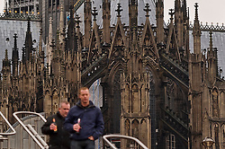 Cologne, Germany, Jan. 2012 -  Pedestrians navigate stairs on Heinrich-Böll-Platz, in front of the Cologne Dom Cathedral in Cologne, Germany. Officially, Hohe Domkirche St. Peter und Maria (or The High Cathedral of Saints Peter and Mary), is a Roman Catholic church in Cologne, Germany. It is the seat of the Archbishop of Cologne and the administration of the Archdiocese of Cologne. It is renowned monument of German Catholicism and Gothic architecture and is a World Heritage Site. It is Germany's most visited landmark, attracting an average of 20,000 people a day. The Cologne Cathedral was built between 1248 and 1880. It is 144.5 meters (474 ft) long, 86.5 m (284 ft) wide and its towers are approximately 157 m (515 ft) tall. The cathedral is the largest Gothic church in Northern Europe and has the second-tallest spire and largest facade of any church in the world. The choir has the largest height to width ratio of any medieval church. (Photo © Jock Fistick)